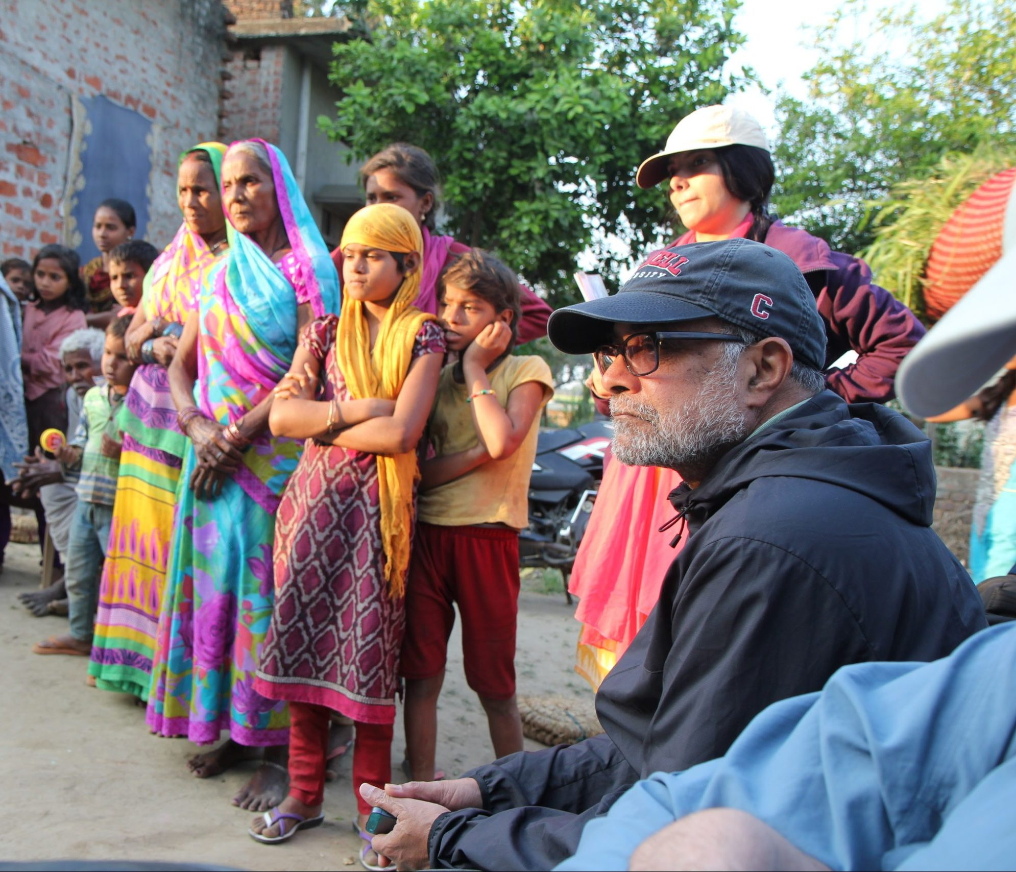 Prabhu Pingali and others standing outside