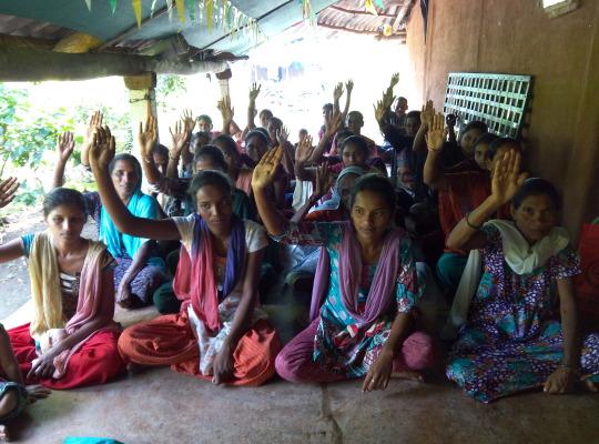 group of women raising hands